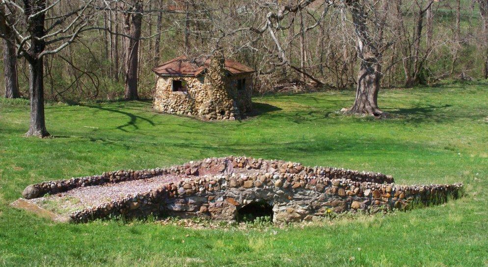 little stone house with bridge