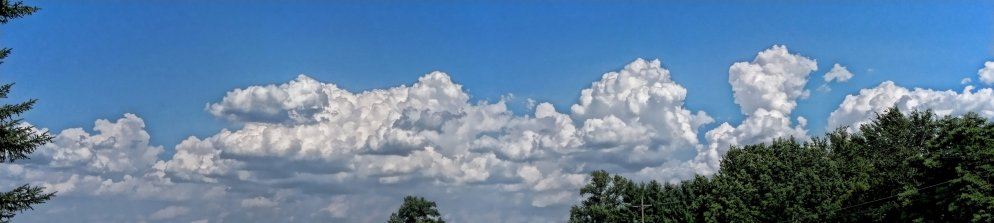 puffy clouds along east horizon, late july