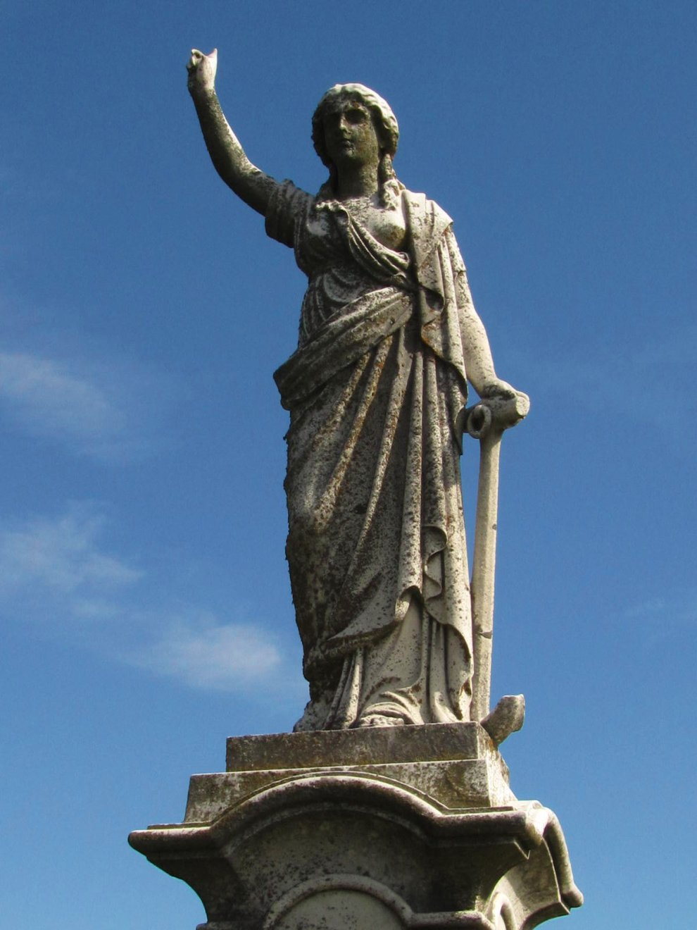 tall angel monument in local cemetery