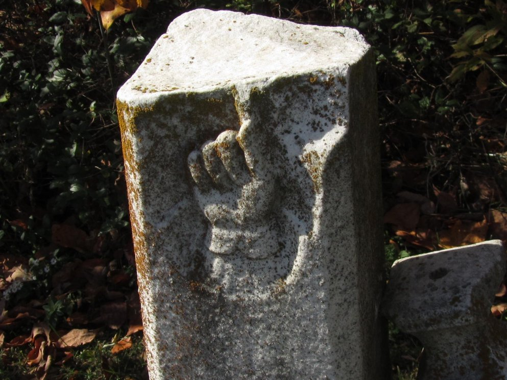 bas relief hand image on a very old tombstone