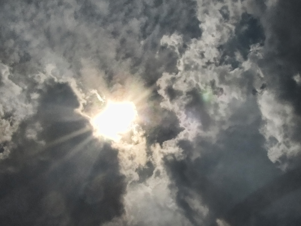 clouds and sun before a storm